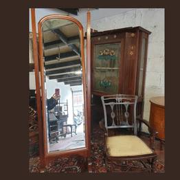 Mahogany Cheval Mirror made by O'Connell Lavits Quay, Cork. Sitting beside an Edwardian Bedroom Chair
